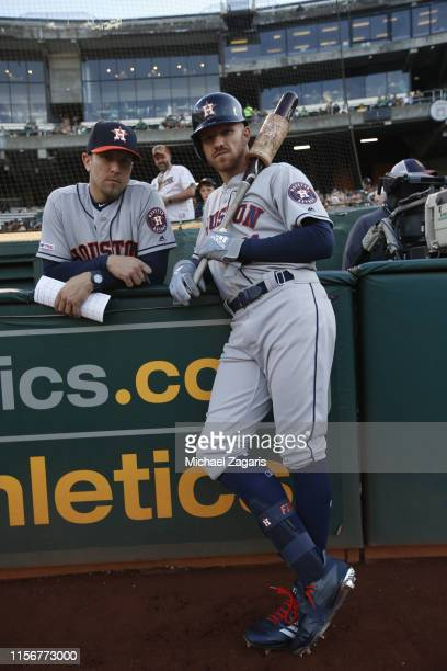 Hitting Coach Alex Cintron and Derek Fisher of the Houston Astros talk at the dugout prior to the game against the Oakland Athletics at the...