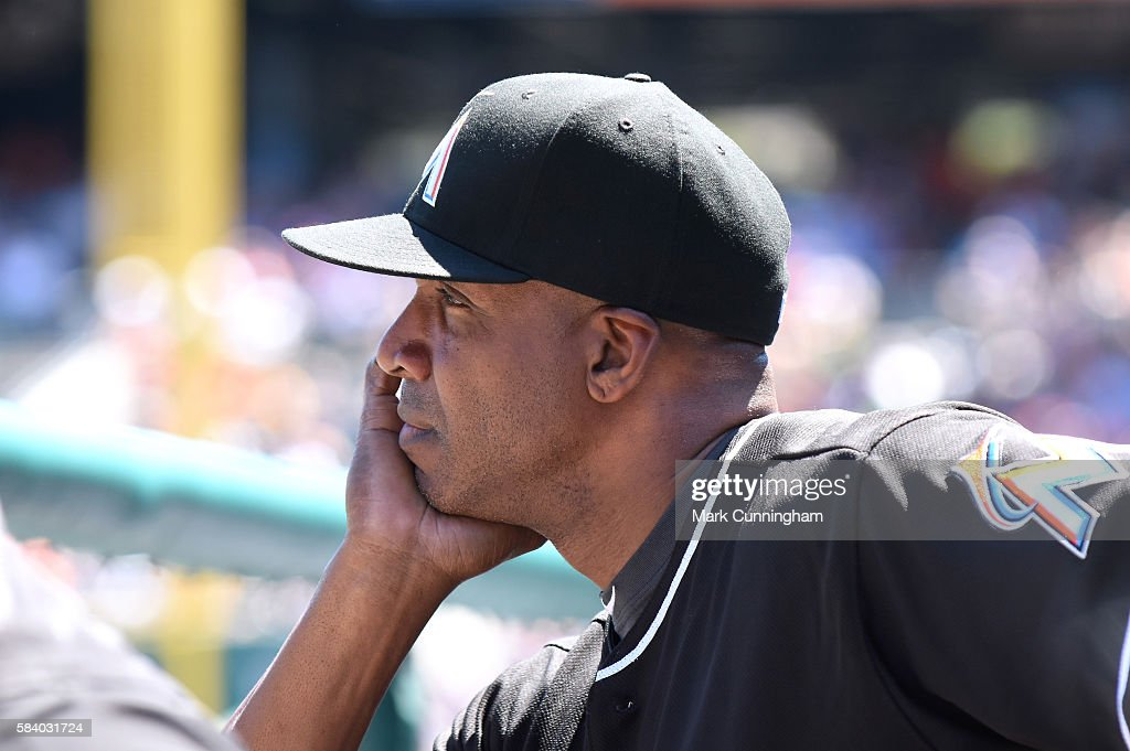 Hitting coach Barry Bonds #25 of the Miami Marlins looks on from the dugout during the game against the Detroit Tigers at Comerica Park on June 29, 2016 in Detroit, Michigan. The Tigers defeated the Marlins 10-3.
