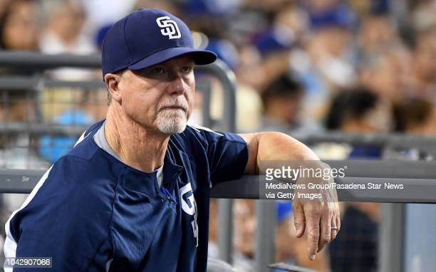 Hitting coach Mark McGwire of the San Diego Padres looks on against the Los Angeles Dodgers in the third inning of a Major League Baseball game at...
