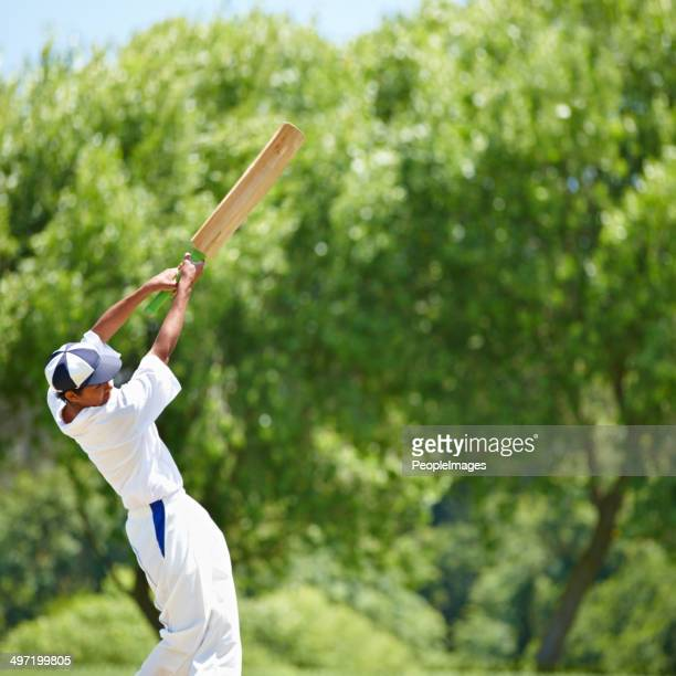 hitting the ball with all his strength for victory - cricket bat stock pictures, royalty-free photos & images
