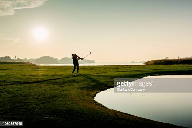 hitting the perfect pitch shot. - golf swing stock pictures, royalty-free photos & images