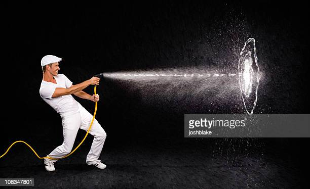 hitting the target - spray stock pictures, royalty-free photos & images
