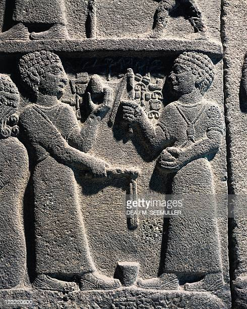 Hittite civilization 9th8th century bC Relief portraying two young people playing with a spinning top From Carchemish Turkey