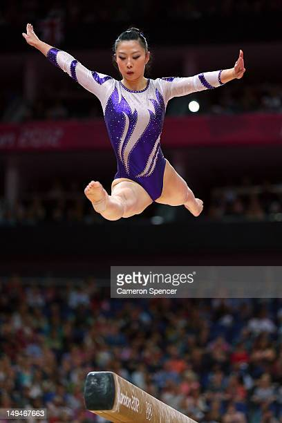 Hiu Ying Angel Wong of Hong Kong competes on the beam in the Artistic Gymnastics Women's Team qualification on Day 2 of the London 2012 Olympic Games...
