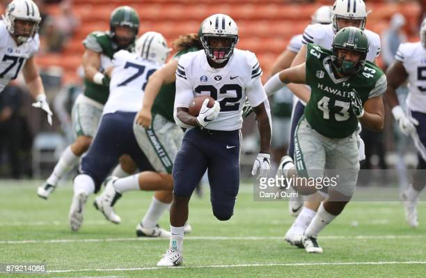 Hiva Lee of the BYU Cougars breaks free from the defense to score a touchdown during the first quarter of the game against the Hawaii Rainbow...