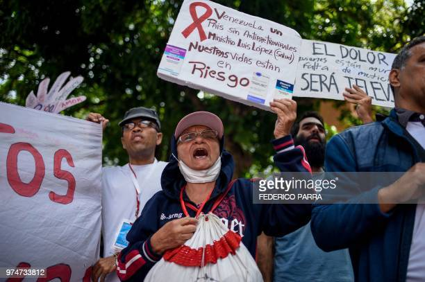 HIVpositive patients and their relatives protest against the lack of medicines and medical supplies in hospitals outside the Pan American Health...