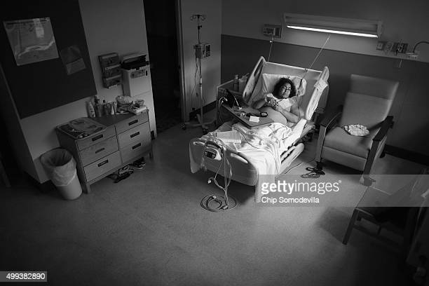 HIVpositive Shana ReynoldsFairley has a moment alone after checking into Georgetown University Hospital to be treated for edema August 30 2013 in...