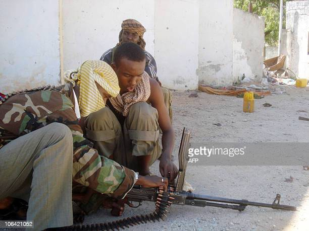 Hizbul Islam Militias opposed to the Somali goverment forces load their machine gun in Mogadishu on November 1 2010 Fresh fighting killed 12 people...