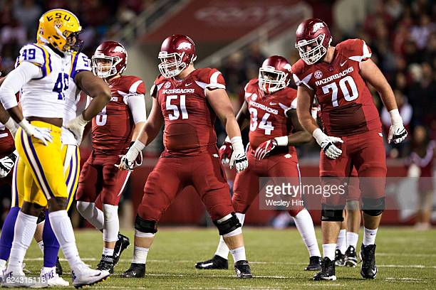 Hjaite Froholdt and Dan Skipper of the Arkansas Razorbacks at the line of scrimmage during a game against the LSU Tigers at Razorback Stadium on...