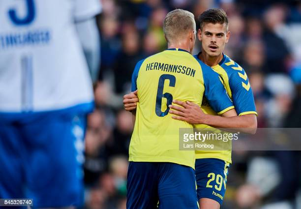 Hjortur Hermannsson and Jan Kliment of Brondby IF celebrate after scoring their first goal during the Danish Alka Superliga match between OB Odense...