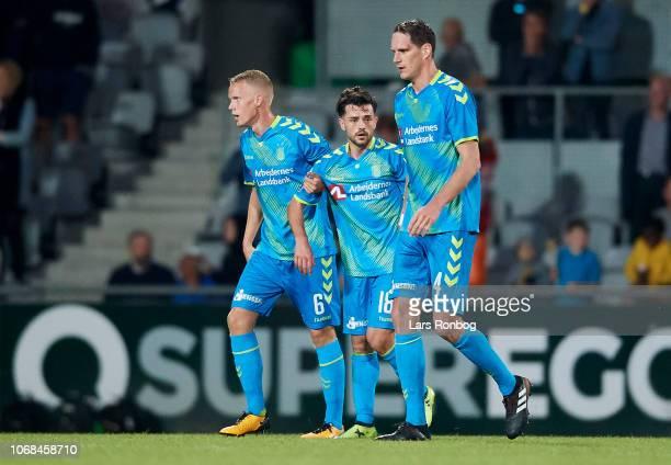 Hjortur Hermannsson Besar Halimi and Benedikt Rocker of Brondby IF looking dejected during the Danish Alka Superliga match between AC Horsens and...