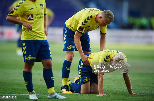 Hjortur Hermannsson of Brondby IF treats an injured Johan Larsson of Brondby IF during the UEFA Europa League Qualification match between Brondby IF...