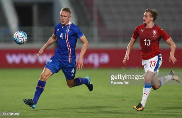Hjortur Hermannsson of Iceland is chased by Jan Kopic of the Czech Republic during the international friendly match between Iceland and Czech...