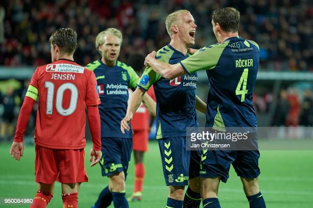 Hjötur Hermannsson of Brondby IF and Benedikt Röcker of Brondby IF celebrate after the 24 goal from Hjötur Hermannsson during the Danish Alka...