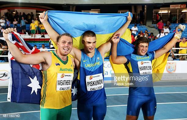 Hlib Piskunov of the Ukraine, Mykhailo Havryliuk of the Ukraine and Ned Weatherly of Australia celebrate after the Boys Hammer Throw Final on day...
