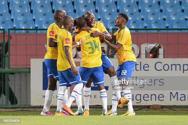 Hlompho Kekana celebrates with his players during the Absa Premiership match between Mamelodi Sundowns and Ajax Cape Town at Loftus Stadium on April...