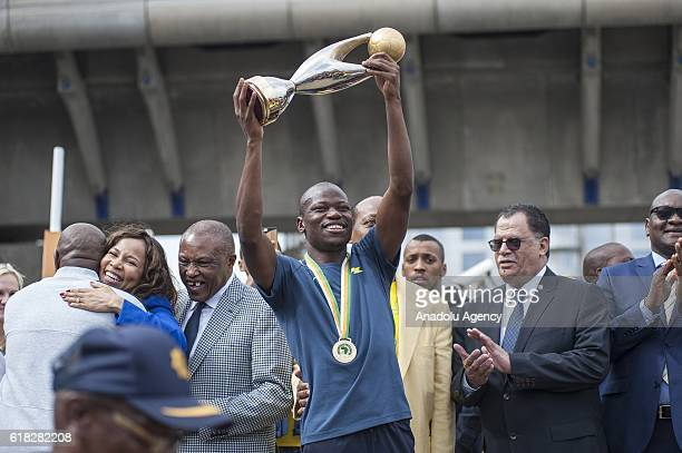 Hlompho Kekana of Mamelodi Sundowns holds the trophy as the team arrives at the Tambo Airport after they were crowned 2016 CAF Champions League...