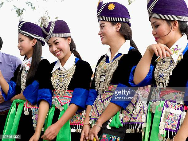 Hmong Der women playing the ball throwing game of 'pov pob' at Ban Km 52 Hmong New Year festival Vientiane province Lao PDR 'Pov pob' is a formalised...
