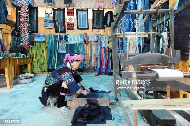 Hmong hilltribe woman weaves traditional clothes at the Lao Chai village on November 8 2013 in Sa Pa Vietnam Sa Pa with its differents ethnic...