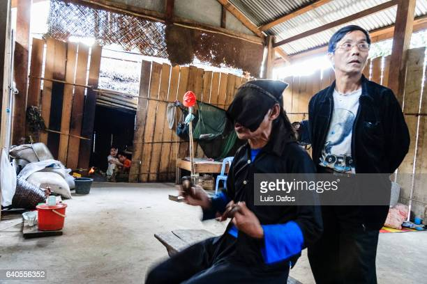hmong shaman performing a healing ritual - laotian culture stock pictures, royalty-free photos & images