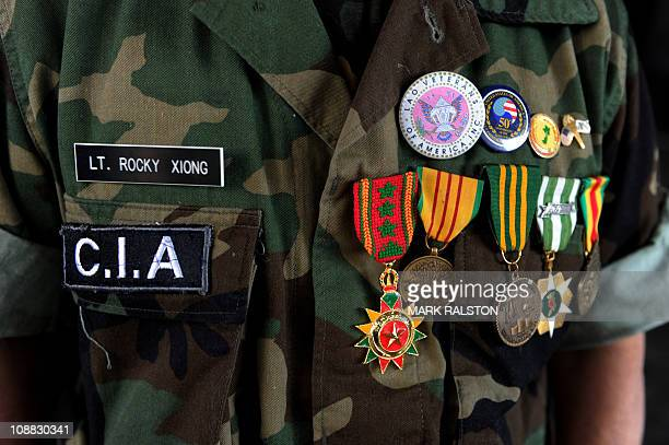 A Hmong war veteran shows his medals as he waits for the start of the five day funeral of General Vang Pao in Fresno Central California on February 4...