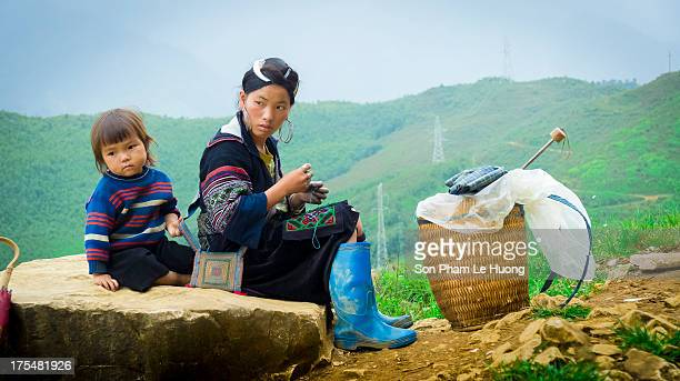 CONTENT] Hmong woman and her kid on the road of Sa Pa Lao Cai province Vietnam on Sep 28 2012