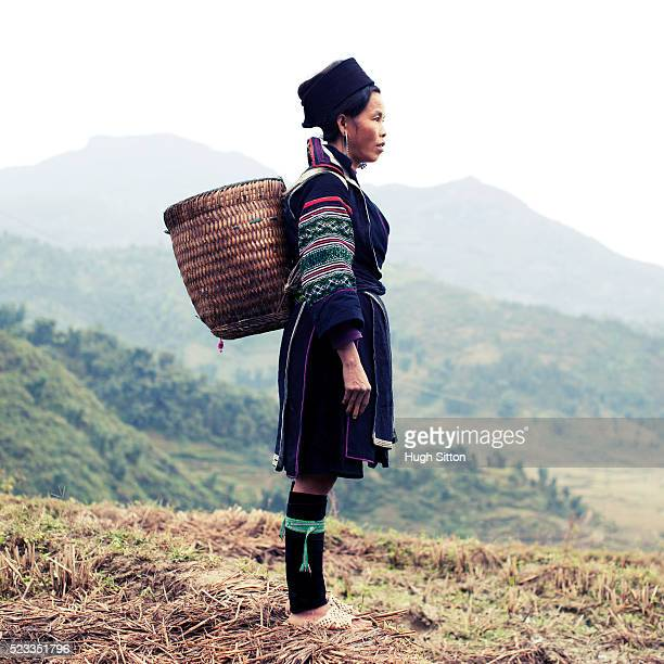 hmong woman standing in the landscape of sapa - hugh sitton stock pictures, royalty-free photos & images