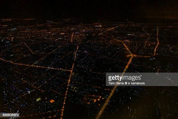 Ho Chi Minh City in Vietnam, night time aerial view from airplane