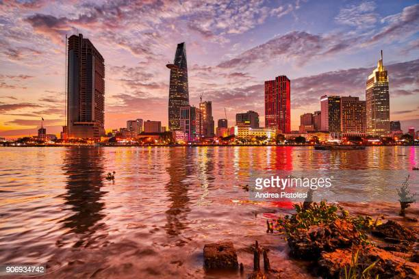 ho chi minh city skyline in saigon river, vietnam - ho chi minh city stock pictures, royalty-free photos & images