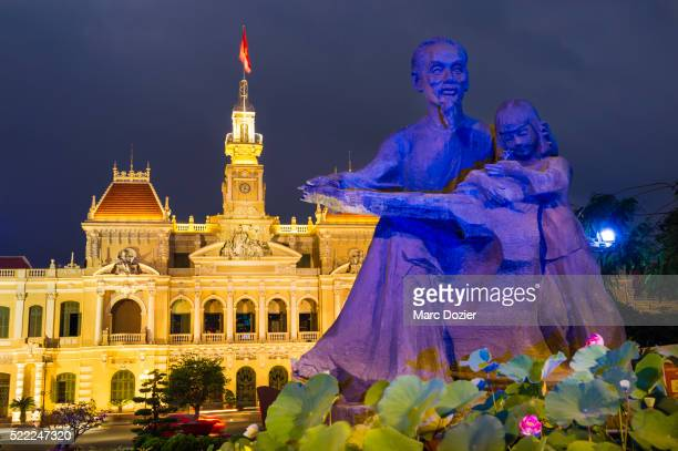 ho chi minh city town hall with ho chi minh statue - south vietnam stock pictures, royalty-free photos & images