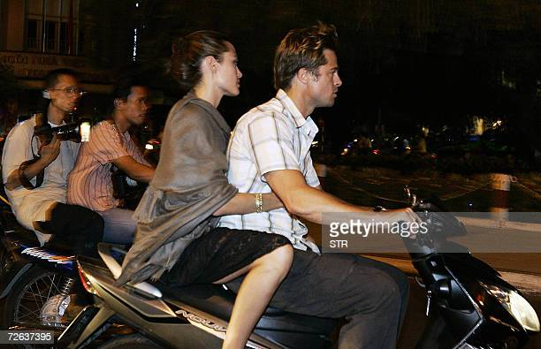 A local photographer tries to get a shot of Hollywood stars Brad Pitt and his partner Angelina Jolie as they leave the Temple Club restaurant where...