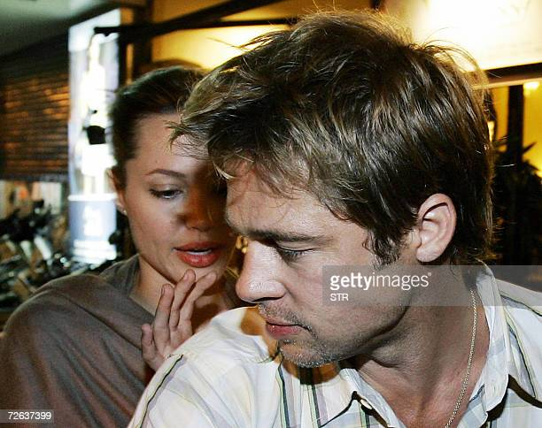 Hollywood stars Brad Pitt and his partner Angelina Jolie leave the Temple Club restaurant where they had dinner in downtown Ho Chi Minh city late 23...