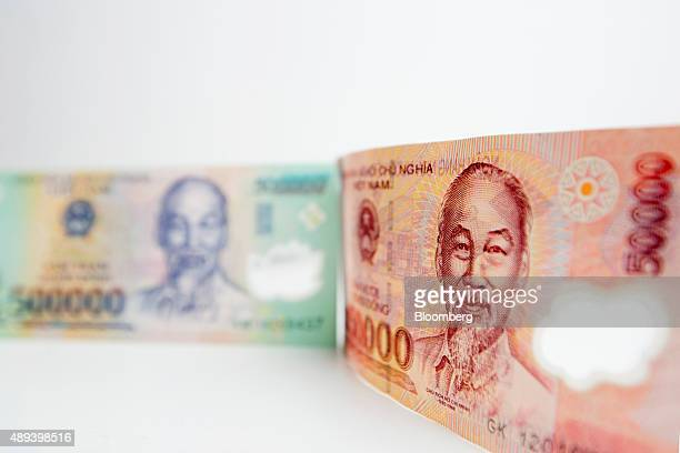Ho Chi Minh former prime minister and president of Vietnam is displayed on a Vietnamese 500000 dong and a 50000 dong banknotes in an arranged...