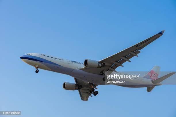 Ho Chi Minh, Vietnam - 24 Frebuary, 2019 :  China Airlines airplane fly against the sky