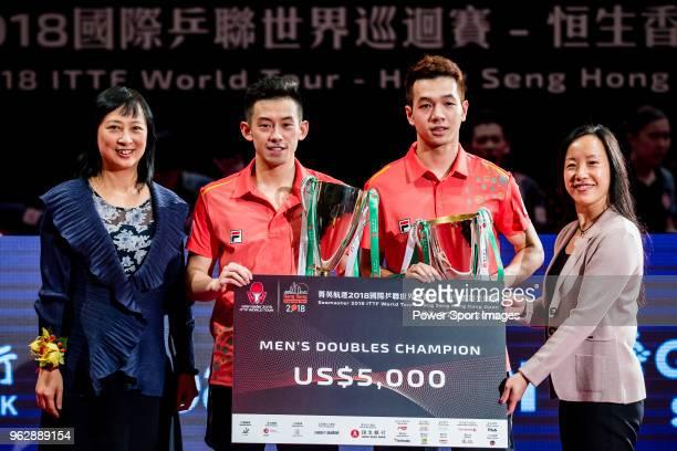 Ho Kwan Kit and Wong Chun Ting of Hong Kong pose with their prize after winning the men's doubles - final match against Masataka Morizono and Yuya...