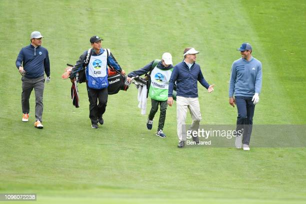 Ho Sung Choi of South Korea Chris O'Donnell and Aaron Rodgers walk down the sixteenth hole fairway during the second round of the ATT Pebble Beach...