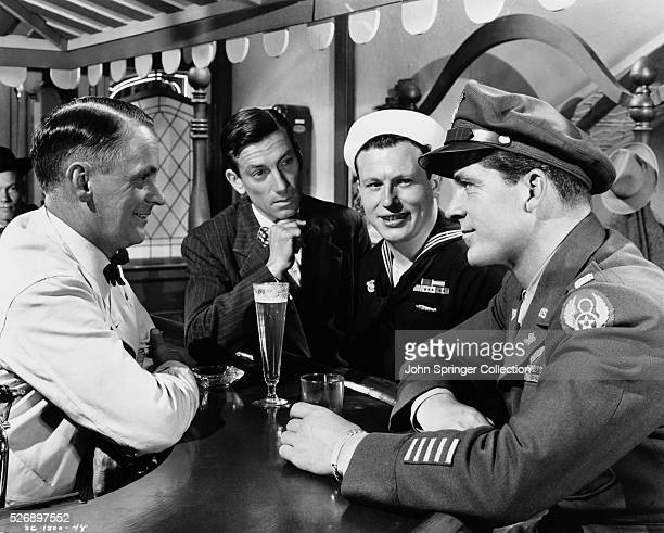 Hoagy Carmichael as Uncle Butch Harold Russell as Homer Parrish and Dana Andrews as Fred Derry in the 1946 film The Best Years of Our Lives