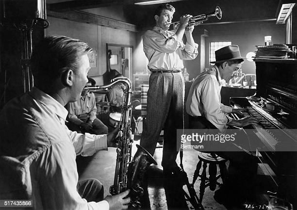Hoagy Carmichael playing piano and Kirk Douglas playing trumpet in a scene from the 1950 film Young Man with a Horn, directed by Michael Curtiz.