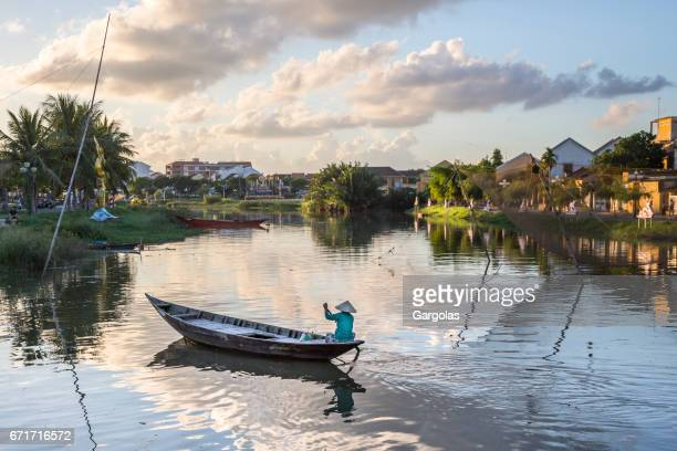 hoai river in ancient hoian town - dugout canoe stock photos and pictures