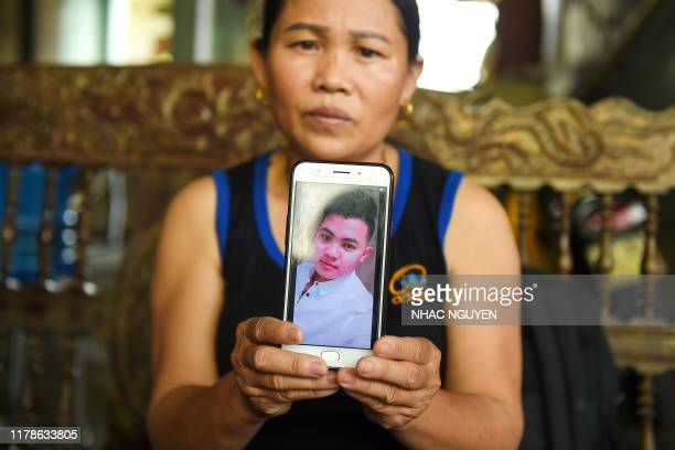 Hoang Thi Ai, mother of 18-year old Hoang Van Tiep who is feared to be among the 39 people found dead in a truck in Britain, poses with her son's...