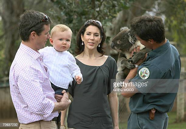 A staff member of the Bonorong Wildlife Park introduces a Koala to Denmark's Crown Princess Mary and her husband Prince Frederik holding their...