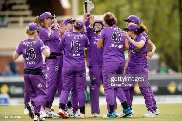 Hobart Hurricanes players celebrate a wicket during the Women's Big Bash League match between the Hobart Hurricanes and the Melbourne Stars at...