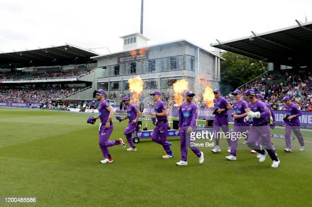 Hobart Hurricanes take the field during the Big Bash League match between the Hobart Hurricanes and the Adelaide Strikers at the University of...