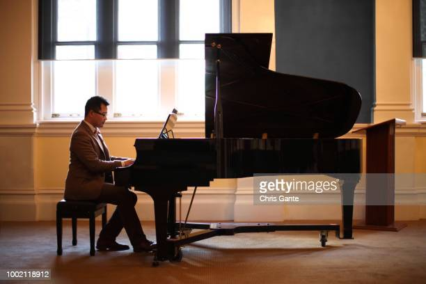 hobbies; a pianist rehearses his performance, right view - grand piano stock pictures, royalty-free photos & images