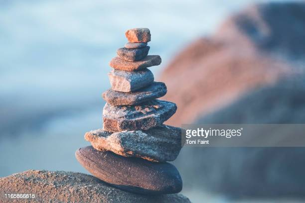 a hobby of rock stacking - mindfulness stock pictures, royalty-free photos & images