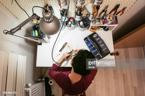 hobbyist working in home workshop - inventor stock pictures, royalty-free photos & images