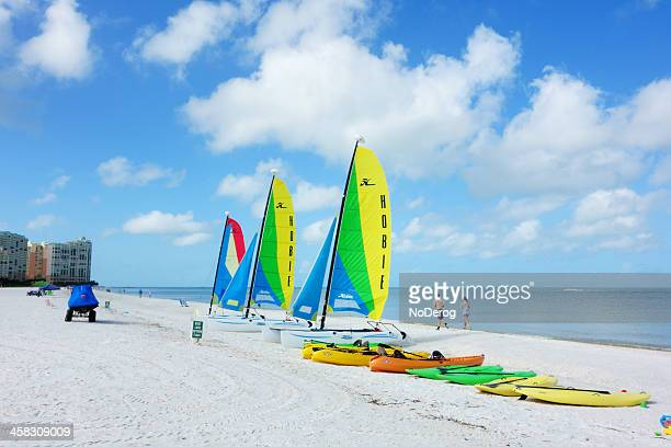 hobie catamaran sailboats on the beach - marco island stock pictures, royalty-free photos & images