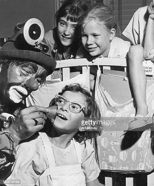 OCT 12 1960 Hobo Clown Plays Doctor Beverly Richards of 134 S Decatur St Shelli Secrest Colby Kan' and Wendy Wilson 6 of 6905 W 32nd Ave Bozo who...