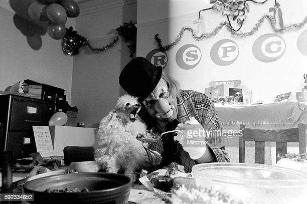 'Hobo' plays host to the doggy guests enjoying a menu of biscuits dogmeat turkey gravysauce and chocolatedrops December 1970 7011583013