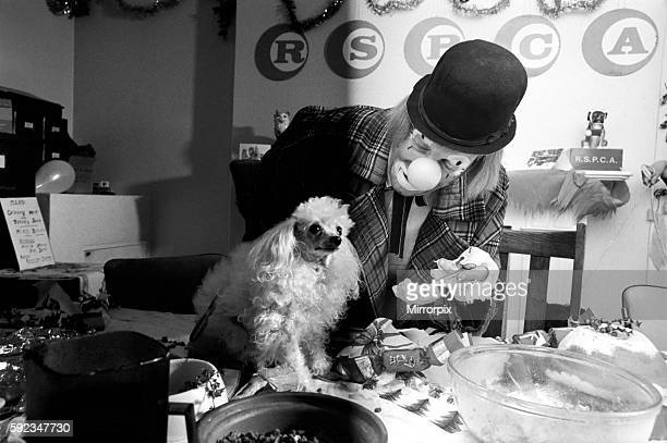 'Hobo' plays host to the doggy guests enjoying a menu of biscuits dogmeat turkey gravysauce and chocolatedrops December 1970 7011583015